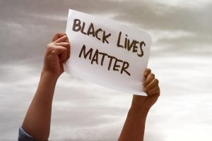 Black lives matter poster. Blog on mental health and managing feelings of racism in America. In response to the murders of George Floyd, trayvon martin, tamir rice, Breonna Taylor, Ahmed Arbury. You may feel depression, anxiety, low self-esteem, hurt, frustration, anger. It is normal. structural racism impacts all areas of life.