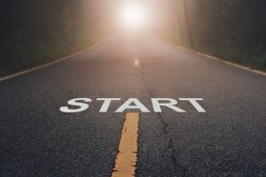 "Image of the word ""start"" on a road showing how counseling can help you start your journey toward mental health."