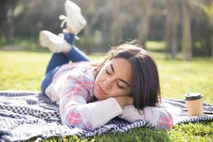 Calm Tranquil Girl Relaxing In Park. Young Woman Lying On Plaid. Counseling EMDR and Trauma in Cleveland, Ohio area 44122. Online therapy. Counseling for depression, anxiety, low self esteem. Feeling exhausted, worried, frustrated, PTSD symptoms. Vicarious trauma support. Assistance with overcoming difficulty sleeping, eating, flashbacks, nightmares, being jumpy and easily startled. Certified EMDRIA therapists in Beachwood, Ohiob