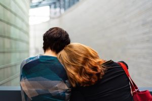woman laying on man's shoulders. relationships impacted by addiction. Codependence counseling and overcome codependent behaviors. Do you enable. Get help with managing anxiety, stress, frustration, low self-esteem, grief with managing addiction. We're here to help you.